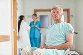 Male patient in a wheelchair looking at camera — Stock Photo