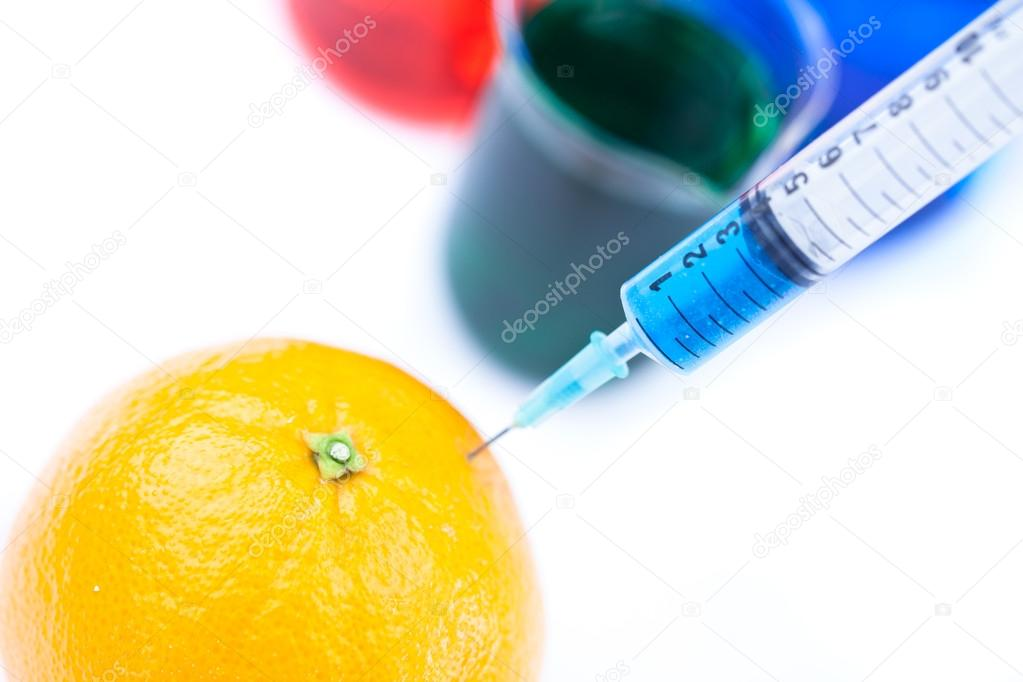 Lemon with a syringe against a white background — Stock Photo #14145980