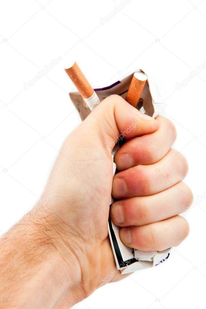 Hand crushing a cigarette pack against a white background — Stock Photo #14146402