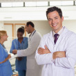 Stock Photo: Doctor next to medical team