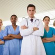 Stock Photo: Doctor and nurses with arms crossed