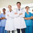 Stock Photo: Doctors with nurses with arms crossed