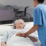 Nurse taking care of an elderly patient — Stock Photo #14151806