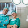 Surgeon and a nurse looking at camera - Stock Photo