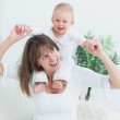 Baby sitting on shoulders of his mother — Stock Photo #14152451