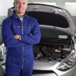 Mechanic standing while looking at camera — Stock Photo