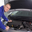Foto Stock: Smiling mechanic looking at camera