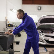 Stock Photo: Mechanic using computer