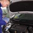 Mechanic using a tablet computer — Stock Photo