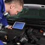 Mechanic checking an engine — Stock Photo