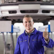 Mechanic standing with thumb up — Stock Photo