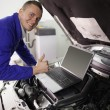 Stock Photo: Mechanic working on a computer