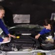 Stock Photo: Mechanics checking car engine