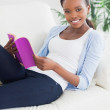 Black woman holding a book — Stock Photo #14154940