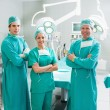 Stock Photo: Surgeons smiling with arms crossed