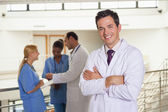 Doctor next to medical team — Stock Photo