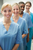 Smiling female nurses looking at camera — Stockfoto