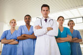 Doctor and nurses with arms crossed — Stock Photo