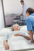 Nurse looking after an elderly patient — Stock Photo