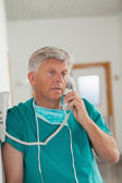 Surgeon calling — Stock Photo