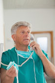 Surgeon talking while holding a phone — Stock Photo