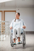 Front view of a thoughtful patient sitting on a wheelchair — Stock Photo