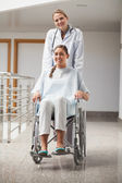Doctor and patient looking at camera — Stock Photo