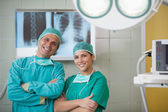 Surgeon and a nurse looking at camera — Stock Photo