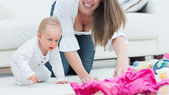 Baby and a mother on all fours — Stock Photo