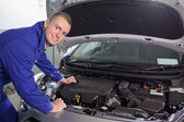 Smiling mechanic looking at camera — Stock Photo