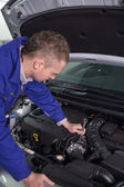 Mechanic repairing an engine with a spanner — Stock Photo