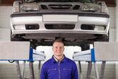 Mechanic below a car — Stock Photo