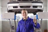 Mechanic standing with thumb up — Stock Photo