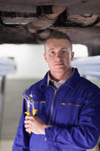 Mechanic holding an adjustable pliers — Stock Photo