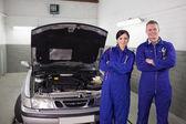 Mechanics next to a car — Stock Photo