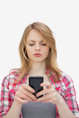 Annoyed woman using a mobile phone — Stock Photo