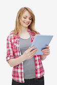Woman holding a tablet computer while standing — Stock Photo