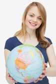 Woman holding a globe — Photo