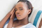 Black woman looking at camera while lying — Stock Photo