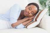 Black woman sleeping while lying on side — Stock Photo