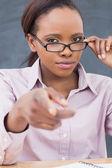Strict black teacher pointing finger — Stock Photo