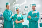 Surgeons standing up with arms crossed — Stock Photo