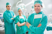 Surgical team smiling with arms crossed — Stock Photo