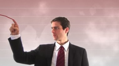Stock Footage of Businessman showing downward Graph — Stock Video