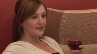 Woman Relaxing with a Glass of Wine — Stock Video