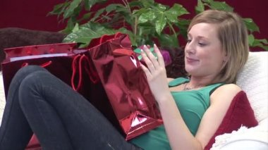 Woman on Sofa with Christmas Presents — Stock Video