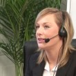 Attractive Blonde on Headset — Stock Video #14607793