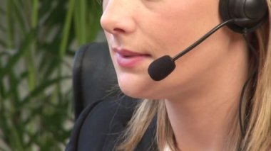 Attractive Blonde on Headset — Stock Video