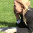 Woman lying on grass using laptop computer — Stock Video #14611787