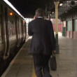 Stock Video: Business mat Train station